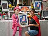 Denise purchased a Ninja Eraser painting in support of talented ten-year-old artist Caitlin McCollum. © Denise Gary