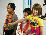 Kids participate in a hula song. © Denise Gary