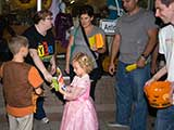Debbie Brown and Robert Gary give <em>Highlights</em> and other goodies to the kids. &copy; Denise Gary