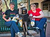 KNTR staffers Denise Gary and Debbie Brown enjoy their first shipment of New Mexico chips and salsa. © Robert Gary