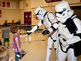 The kids got to meet and shake hands with the Stormtroopers after picking out their comics. © Denise Gary