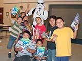 The kids gathered in groups to pose with the Troopers. One boy tried in vain to give rabbit ears to TK-2035! © Denise Gary