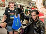 Wolverine hands out KNTR goodie backpacks. © Bruce Matsunaga