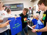 Denise hands out goodie backpacks, sponsored by Bookmans. © Robert Gary